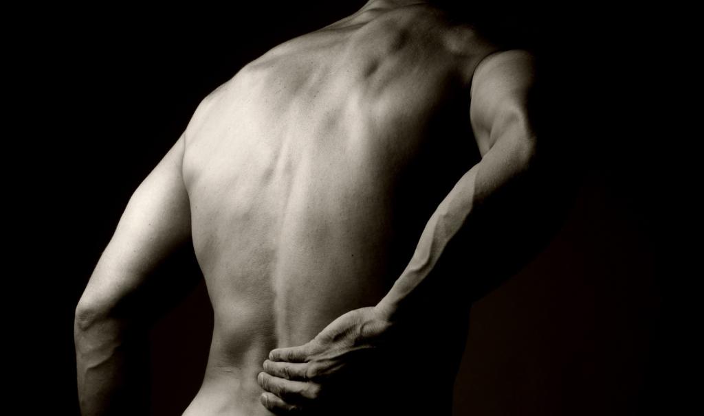 Острая боль внизу спины